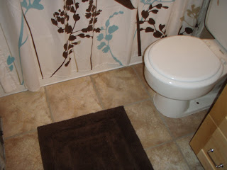 Sticky tiles installed on a bathroom floor - cultivatedrambler.com