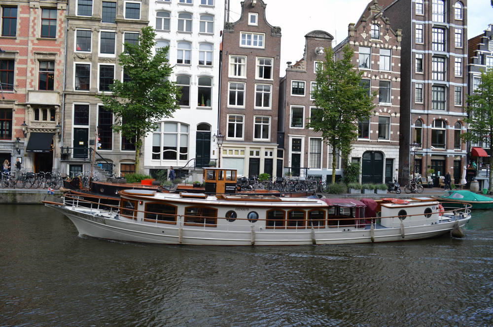 Amsterdam canal and boat - cultivatedrambler.com